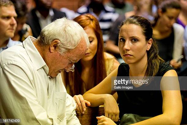 Henke Pistorius and Aimee Pistorius attend the Pretoria Magistrate court hearing on February 15 in Pretoria South Africa Oscar Pistorius stands...