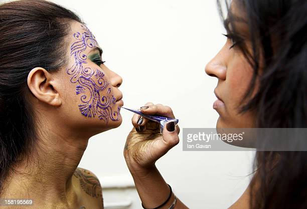 Henna Artist Pavan Ahluwalia applies ink to model Zara during a photo shoot in her studio on December 5 2012 in IlfordLondon England
