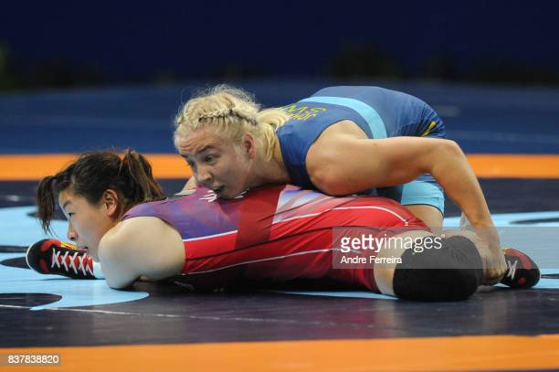 Henna Katarina Johansson of Sweden and Eunsil Jang of South Korea during the female 63 kg wrestling competition of the Paris 2017 Women's World...