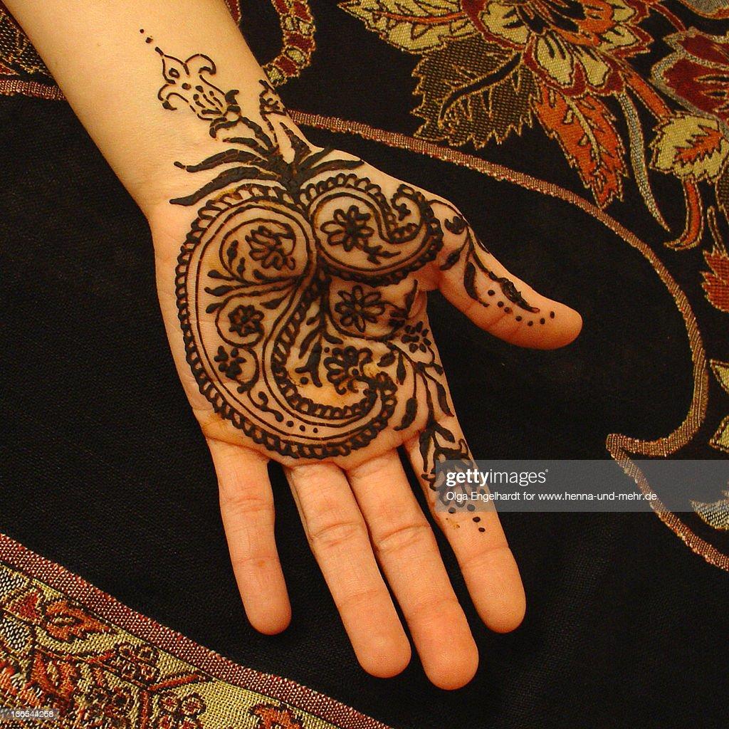 Henna on woman hand : Stock Photo