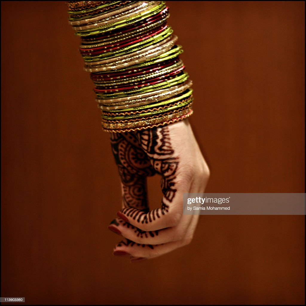 Henna Painted Hand with Bangles : Stock Photo