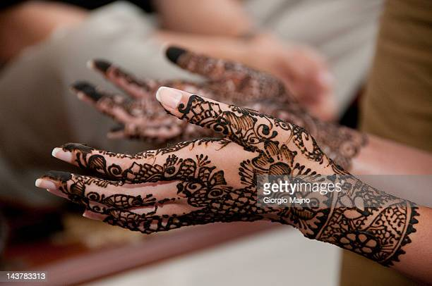 Henna-patterned hands of an Indian bride-to-be