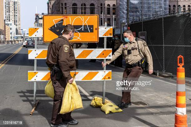 Hennepin County sheriff opens a road blocked by demonstrators in front of the Hennepin County Government Center on March 9, 2021 in Minneapolis,...