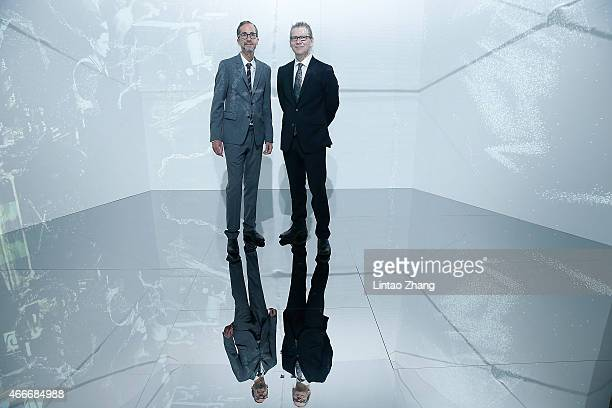 Hennessy 250 Tour Curator Herve Mikaeloff and Artist Charles Sandison pose in art installation by Charles Sandison during the Hennessy 250 Tour at...