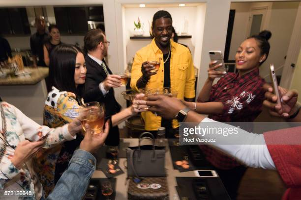 Hennessy Business Development Manager ThuyAnh J Nguyen Lance Gross and Rebecca Jefferson attend Hennessy Le Voyage hosted by ThuyAnh J Nguyen on...