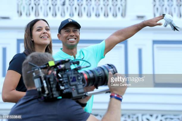Henni Zuel Golf Channel television presenter reacts with Tiger Woods of the United States on stage during the 'Hero Shot at Baha Mar' held at the...