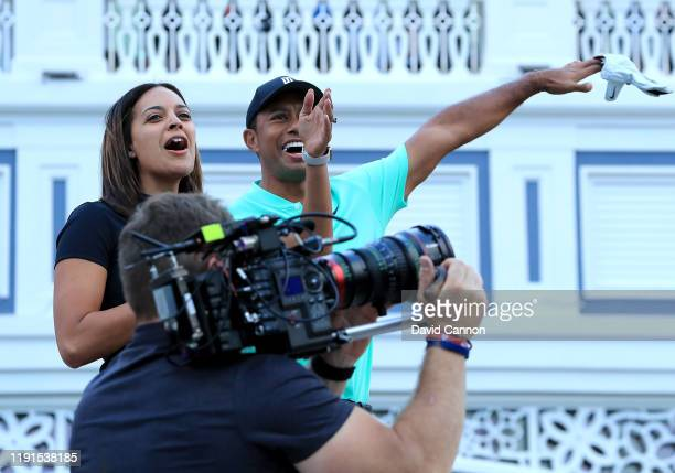Henni Zuel the Golf Channel television presenter reacts with Tiger Woods of the United States on stage during the 'Hero Shot at Baha Mar' held at the...