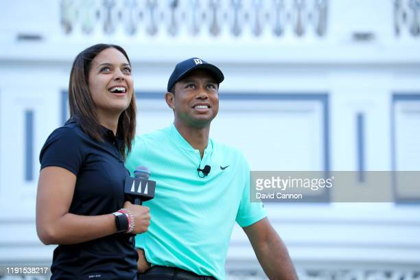 Henni Zuel the Golf Channel television presenter watches a shot with Tiger Woods of the United States on stage during the 'Hero Shot at Baha Mar'...