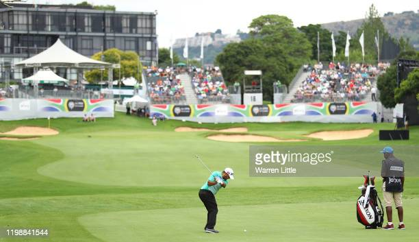 Hennie Du Plessis of South Africa plays into the 18th green during the third round of the South African Open at Randpark Golf Club on January 11,...
