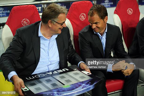 Hennie Spijkerman the second assistant coach of Ajax with the UEFA substitute board and Frank de Boer the head coach / manager of Ajax