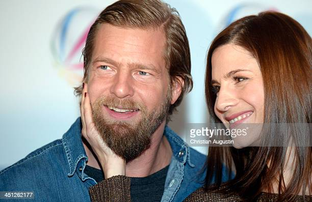 Henning Baum and Christina Hecke attend SAT1 Fiction Event 2013 photocall at Stage Theatre on November 21 2013 in Hamburg Germany