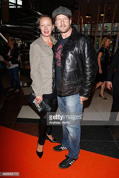 Henning Baum and his wife Corinna Baum attend the premiere of the film 'Nowitzki Der Perfekte Wurf' at Cinedom on September 16 2014 in Cologne Germany