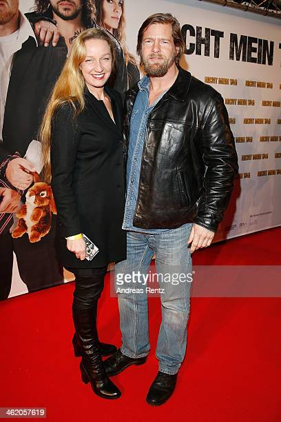 Henning Baum and his wife Corinna Baum attend the world premiere of the film 'Nicht mein Tag' at UCI cinema on January 12 2014 in Bochum Germany