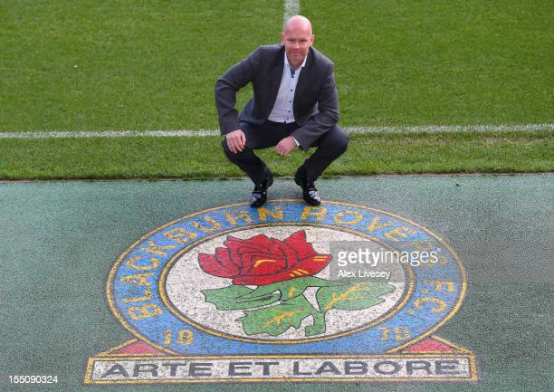 Henning Berg the new manager of Blackburn Rovers poses next to the club badge after a press conference to announce his appointment at Ewood park on...