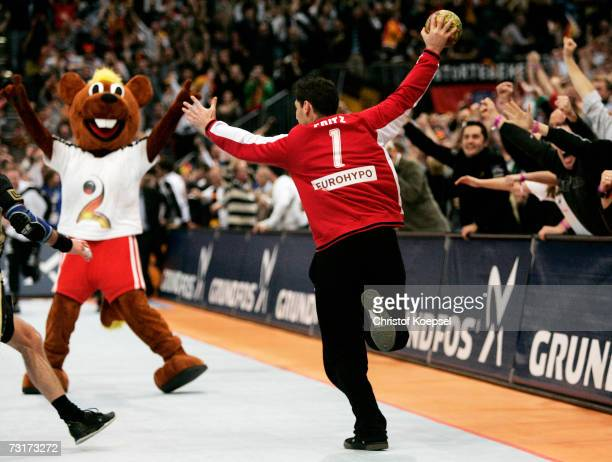 Henning Fritz of Germany celebrates the 3231 victory in the IHF World Championship semi final game between Germany and France at the Cologne Arena on...