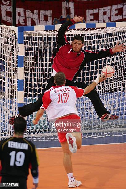 Henning Fritz of Germany saves a shot from Goran Sprem of Croatia in the men's handball gold medal match between Gemany and Croatia on August 29 2004...