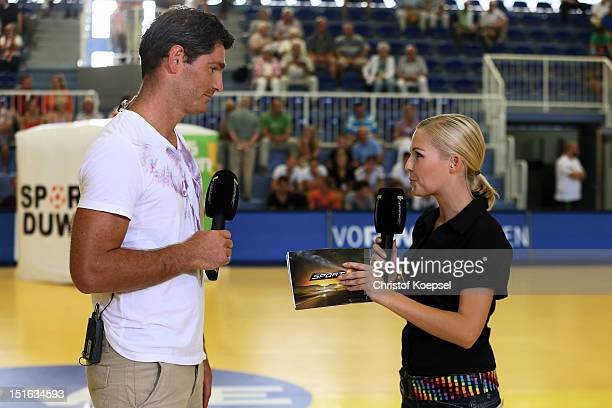 Henning Fritz sport 1 television channel expert talks to sport 1 moderator Anett Sattler during the DKB Handball Bundesliga match between TUSEM Essen...
