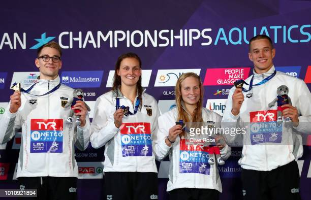 Henning Muehlleitner Annika Bruhn Reva Foos and Jacob Heidtmann of Germany celebrate winning the gold medal during the 4 x 200m Freestyle Swimming...