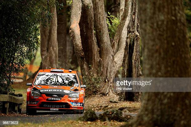 Henning Solberg of Norway and codriver Ilka Minor of Austria drive their Ford Focus RS WRC through the streets of the Auckland Domain during the WRC...