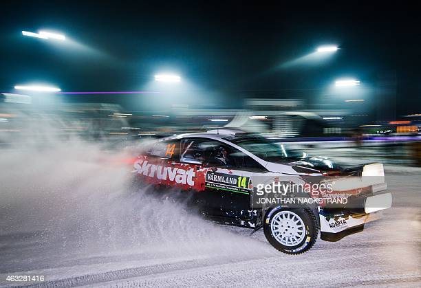 Henning Solberg of Norway and his codriver Ilka Minor of Austria steer their Ford Fiesta WRC during the 1st stage of the Rally Sweden second round of...