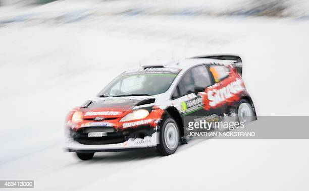 Henning Solberg of Norway and his codriver Ilka Minor of Austria steer their Ford Fiesta WRC during the 13th stage of the Rally Sweden second round...