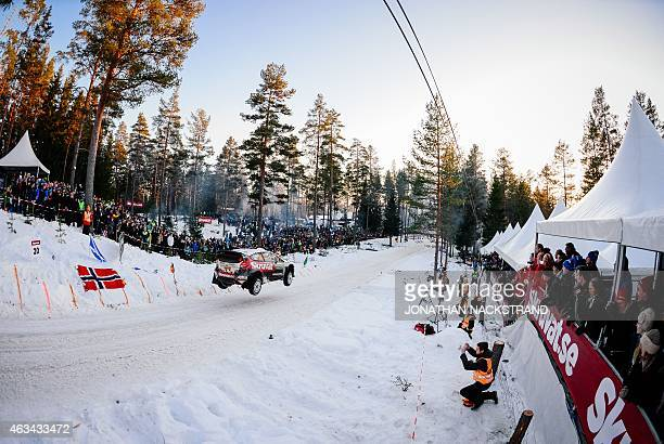Henning Solberg of Norway and his codriver Ilka Minor of Austria steer their Ford Fiesta WRC during the 18th stage of the Rally Sweden second round...