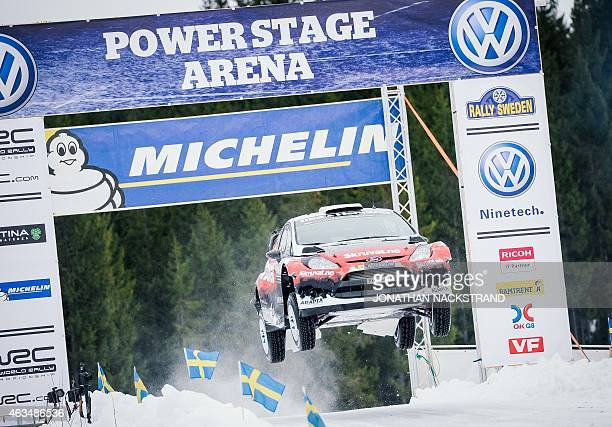 Henning Solberg of Norway and his codriver Ilka Minor of Austria steer their Ford Fiesta WRC during the 20th stage of the Rally Sweden second round...
