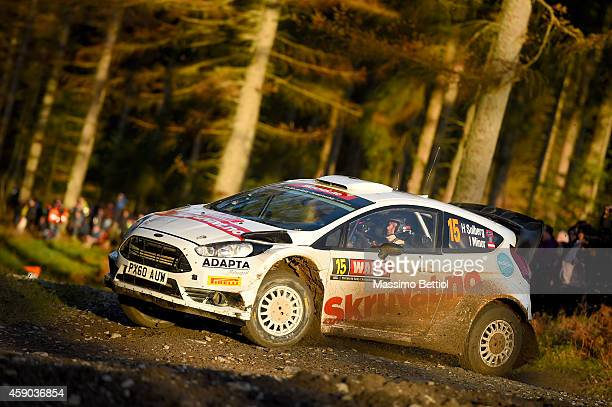 Henning Solberg of Norway and Ilka Minor of Austria compete in their Henning Solberg Ford Fiesta RS WRC during Day Two of the WRC Great Britain on...