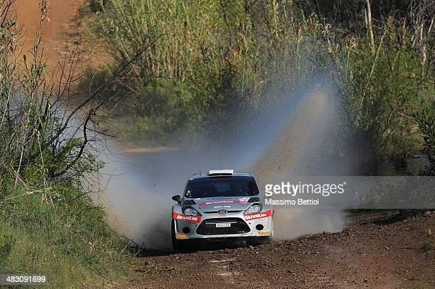 Henning Solberg of Norway and Ilka Minor of Austria compete in their Ford Fiesta RS WRC during Day Three of the WRC Portugal on April 6 2014 in Faro...
