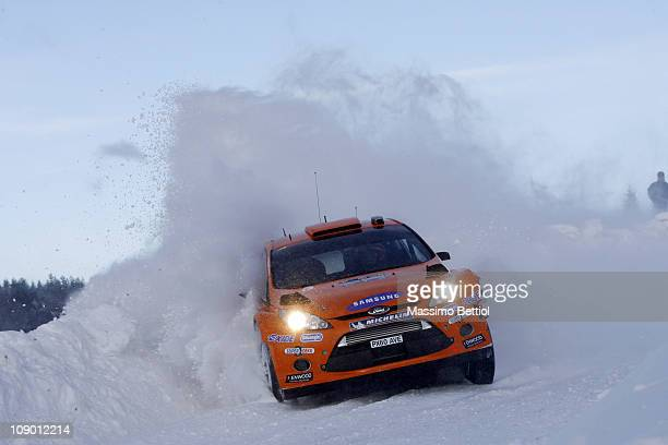 Henning Solberg of Norway and Ilka Minor of Austrian compete in their MSport Ford World Rally Team Ford Fiesta RS WRC during Leg1 of the WRC Rally of...