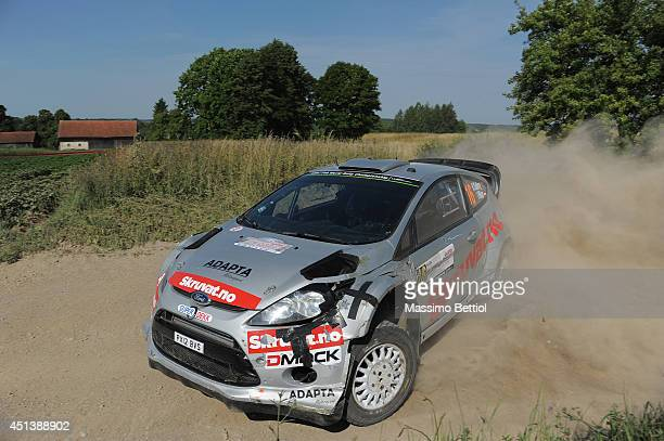 Henning Solberg of Norway and Ilka Minor of Austrian compete in their Ford Fiesta RS WRC during Day Two of the WRC Poland on June 28 2014 in...