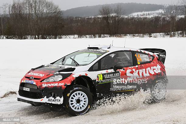 Henning Solberg of Norway and Ilka Minor of Austrian compete in their Adapta Motorsport Ford Fiesta RS WRC during Day one of the WRC Sweden on...