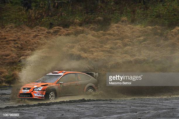 Henning Solberg of Norway and Stephane Prevot of Belgium compete in their Stobart Ford Focus during Leg 1 of the WRC Wales Rally GB on November 12...