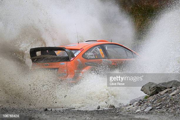 Henning Solberg of Norway drives the Stobart Ford Focus during the Sweet Lamb stage of the Wales Rally GB on November 12 2010 in Llangurig Wales