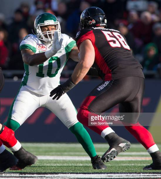 Henoc Muamba of the Saskatchewan Roughriders blocks an Ottawa Redblacks defender in Canadian Football League play during the CFL East Division...