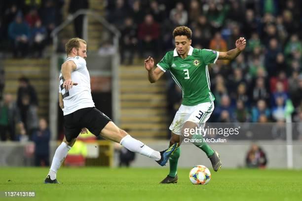 Henri Anier of Estonia tackles Jamal Lewis of Northern Ireland during the 2020 UEFA European Championships group C qualifying match between Northern...
