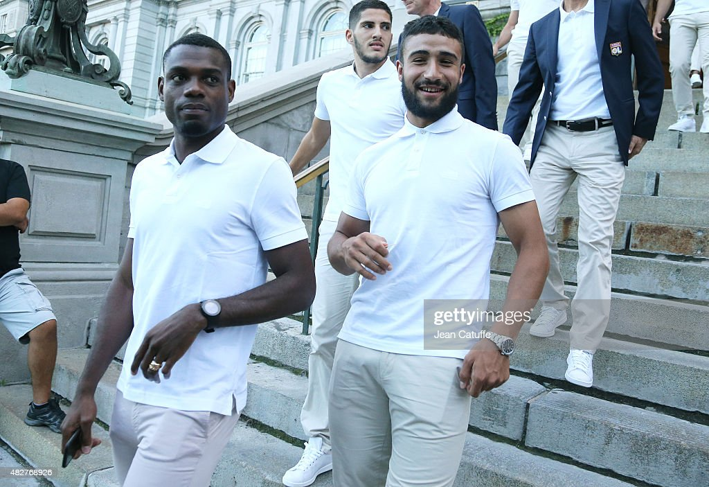 Henri Bedimo and Nabil Fekir of Lyon leave the ceremony presenting the 2015 Trophee des Champions between Paris Saint-Germain (PSG) and Olympique Lyonnais (OL) at Montreal City Hall on July 31, 2015 in Montreal, Quebec, Canada.