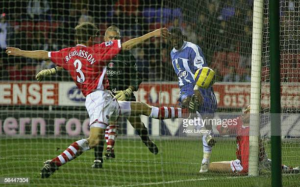 Henri Camara of Wigan Athletic scores his third goal during the Barclays Premiership match between Wigan Athletic and Charlton Athletic at the JJB...
