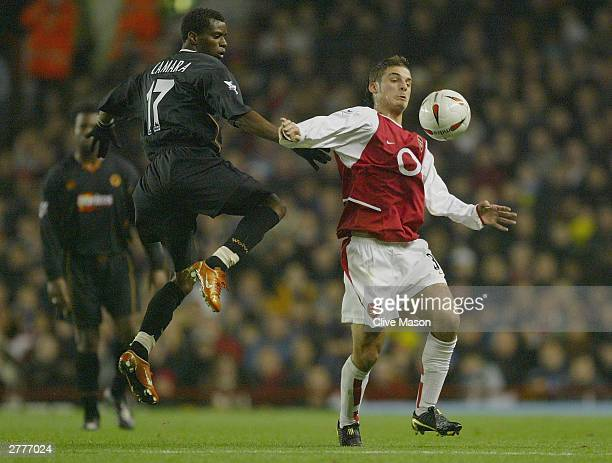 Henri Camara of Wolverhampton Wanderers tries to tackle David Bentley of Arsenal during the Carling Cup fourth round match between Arsenal and...