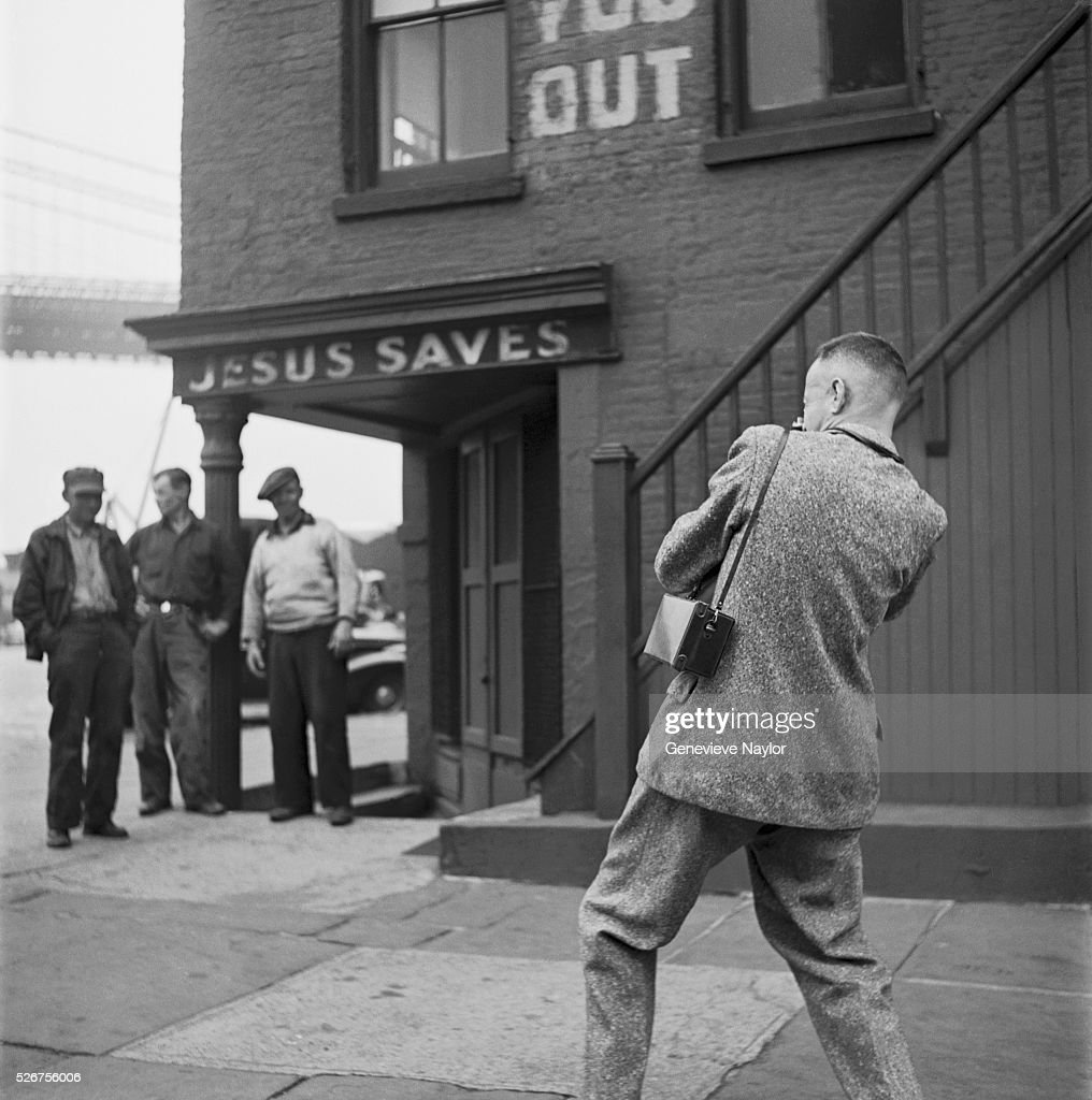 photographing men outside mission pictures getty images henri cartier bresson photographs three men under a jesus saves sign in brooklyn