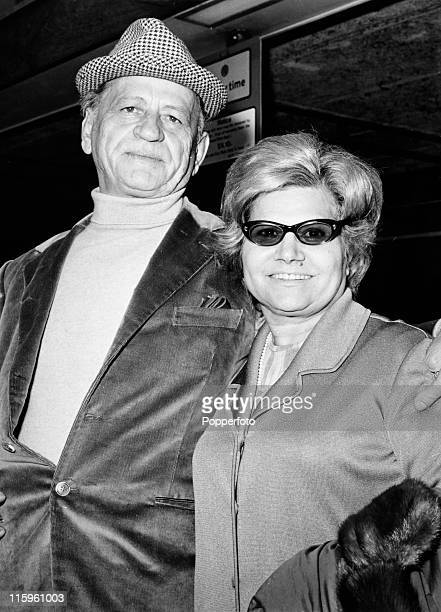 Henri Charriere known as Papillon with his wife at Heathrow Airport London on 14th May 1970