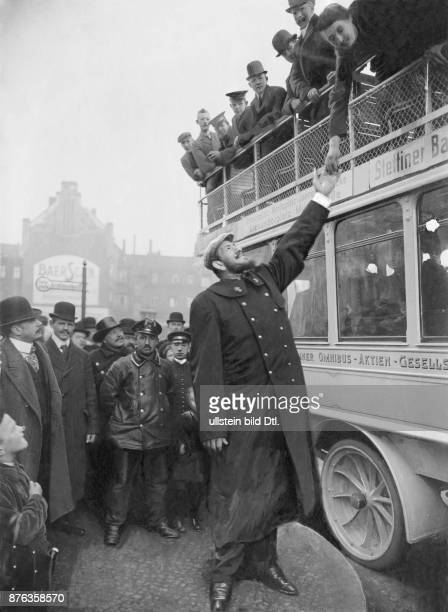 Henri Cot *27041883 alias Joseph Dusorc The French Giant shaking hand with a wmoan sitting on the upper deck of a coach date unknown around 1911