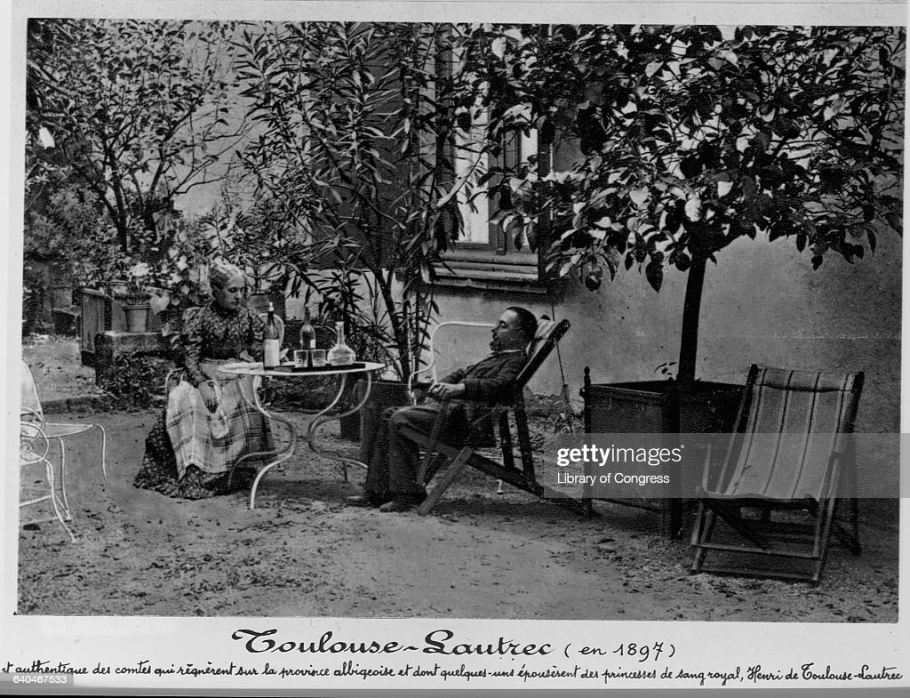 Henri de Toulouse-Lautrec seated at a table outdoors with his mother at Chateau de Malrome, Gironde Department, France.