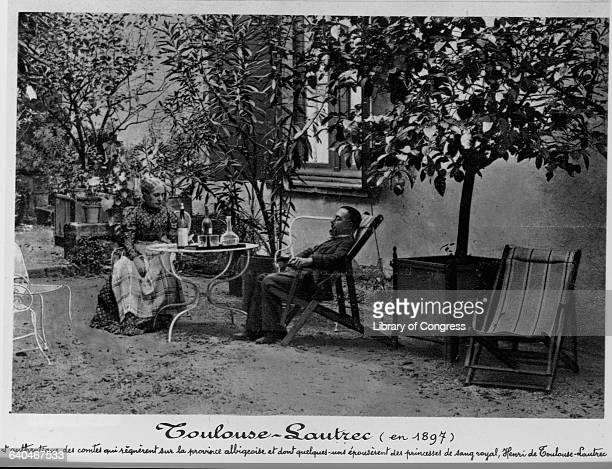 Henri de ToulouseLautrec seated at a table outdoors with his mother at Chateau de Malrome Gironde Department France