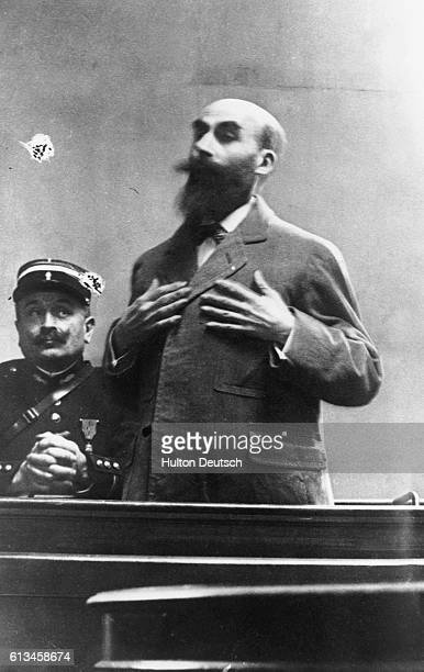 Henri Desire Landru a Frenchman who murdered ten women and a boy in the witness box He was executed in 1922 for his crimes