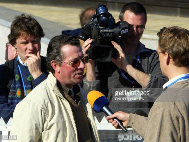 Henri Dumont witness in the Marc Dutroux trial speaks to journalists in front of Arlon's assize court 29 March 2004 AFP PHOTO PHILIPPE HUGUEN