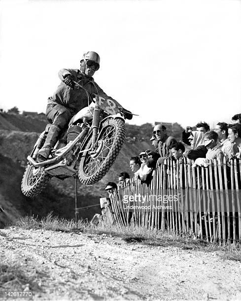 Henri Frantz's machine goes airborne as he hits a hilltop in a race at Paris' Montreuil crosscountry track Paris France September 10 1953 He won the...