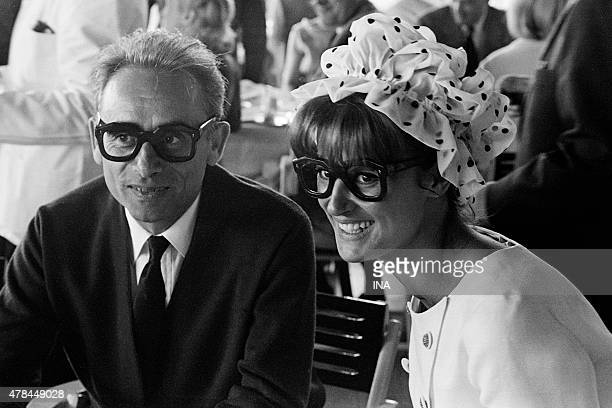 Henri Georges Clouzot and Irene Tunc in a reception with Eden Rock wearing glasses in homage to Harod Lloyd
