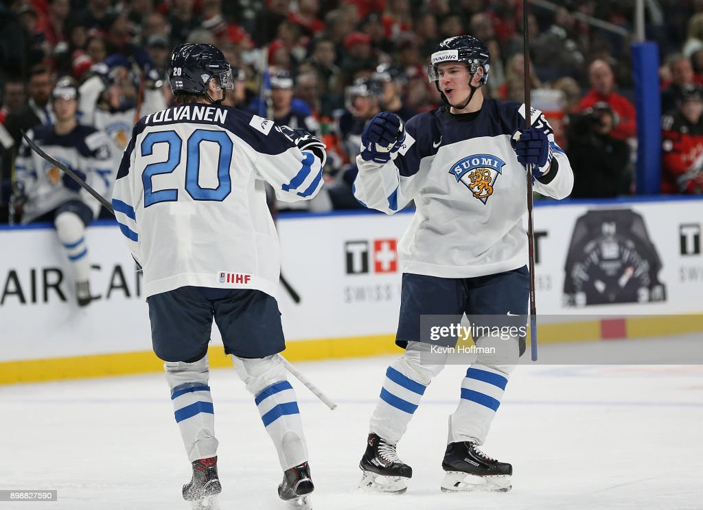 Henri Jokiharju #28 of Finland celebrates his goal against Canada with Eeli Tolvanen #20 during the second period at KeyBank Center on December 26, 2017 in Buffalo, New York.
