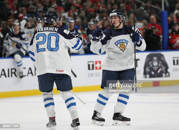 Henri Jokiharju of Finland celebrates his goal against Canada with Eeli Tolvanen during the second period at KeyBank Center on December 26 2017 in...